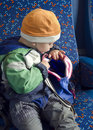 Child With Backpack On Train.