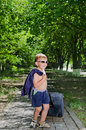 Child with baggage undressed young walking on the road Royalty Free Stock Image