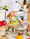 Child bake cookies at kitchen Royalty Free Stock Images