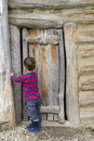 Child at barn door Royalty Free Stock Photo