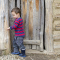 Child at barn door Stock Photo