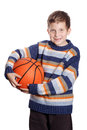 Child with basketball against white background Stock Photo
