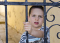 Child behind a gate or fence the iron in steet of town city Royalty Free Stock Photos