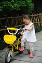 Child with  bicycle Stock Photography