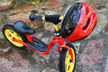 Child bicycle and helmet for two years children selective focus on Royalty Free Stock Image