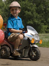 Child and bike toy Royalty Free Stock Photography