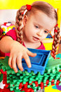 Child with block, construction set in play room. Stock Image