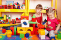 Child with  block  in play room. Royalty Free Stock Photo