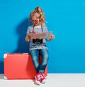 Child blonde girl with pink vintage suitcase and city map ready for summer vacation. Travel and adventure concept Royalty Free Stock Photo