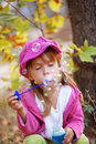 Child blowing bubbles Stock Image