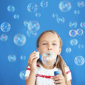 Child blowing soap bubbles portrait of funny lovely little girl Royalty Free Stock Photos