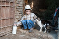 Child with bottle of cow s milk straight from the cow fresh out barn and petting a cat Royalty Free Stock Image