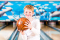 Child bowling with ball Royalty Free Stock Photo