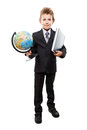 Child boy in business suit holding Earth globe and book Royalty Free Stock Photo