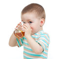 Child boy drinking juice from glass Royalty Free Stock Image