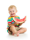Child boy eating watermelon on white Royalty Free Stock Photography