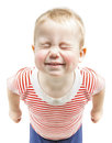 Child boy funny smiling and narrow closed eyes, ha Royalty Free Stock Photo