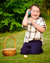Child Boy kid collecting colorful Easter Eggs Stock Photos