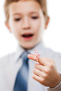 Child boy looking at finger tied string knot memory reminder