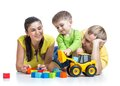 Child boy with parents play building blocks Royalty Free Stock Photo