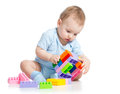 Child boy playing block toy with over white background Royalty Free Stock Photos