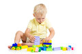 Child boy playing with construction set kid Stock Photography