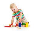 Child boy playing kid wooden toys Royalty Free Stock Photos