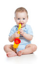 Child boy playing musical toy on white background Royalty Free Stock Images