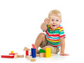 Child boy playing wooden toys kid Stock Images