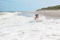 Child boy and sea wave splash cheerful Royalty Free Stock Image