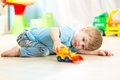 Child boy toddler playing with toy car Royalty Free Stock Photo