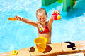 Child with bucket in swimming pool. Stock Photo