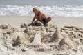 Child build a castle in the sand
