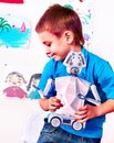 Child build robot toy. Kid engaged robotics in programming classes. Royalty Free Stock Photo