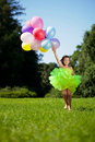 Child with a bunch of balloons in their hands Stock Photo