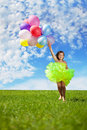 Child with a bunch of balloons in their hands Stock Photos