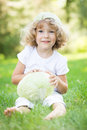 Child with cabbage Royalty Free Stock Images