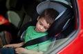 Child in car seat wearing belt Royalty Free Stock Photo