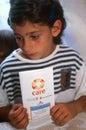A child with a CARE handbook in Kosovo. Stock Photos