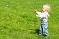 Child catching soap bubbles Royalty Free Stock Photo