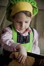 Child Chef Preparing and Eating Royalty Free Stock Photos