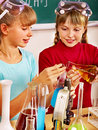 Child in chemistry class happy holding flask Stock Photos