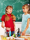Child in chemistry class happy holding flask Stock Photo