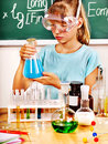 Child in chemistry class holding flask Royalty Free Stock Photo