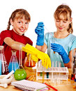 Child in chemistry class holding flask on isolated Stock Image