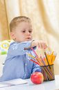 Child choose between colored pencil beautiful Stock Image
