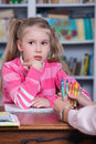 Child chooses the color pencils little girl with hand psychologist Stock Photography