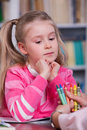 Child chooses the color pencils little girl with hand psychologist Royalty Free Stock Images