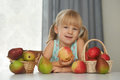 Child choosing a fresh apple to eat Royalty Free Stock Photo