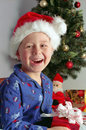 Child and christmas gifts Stock Images